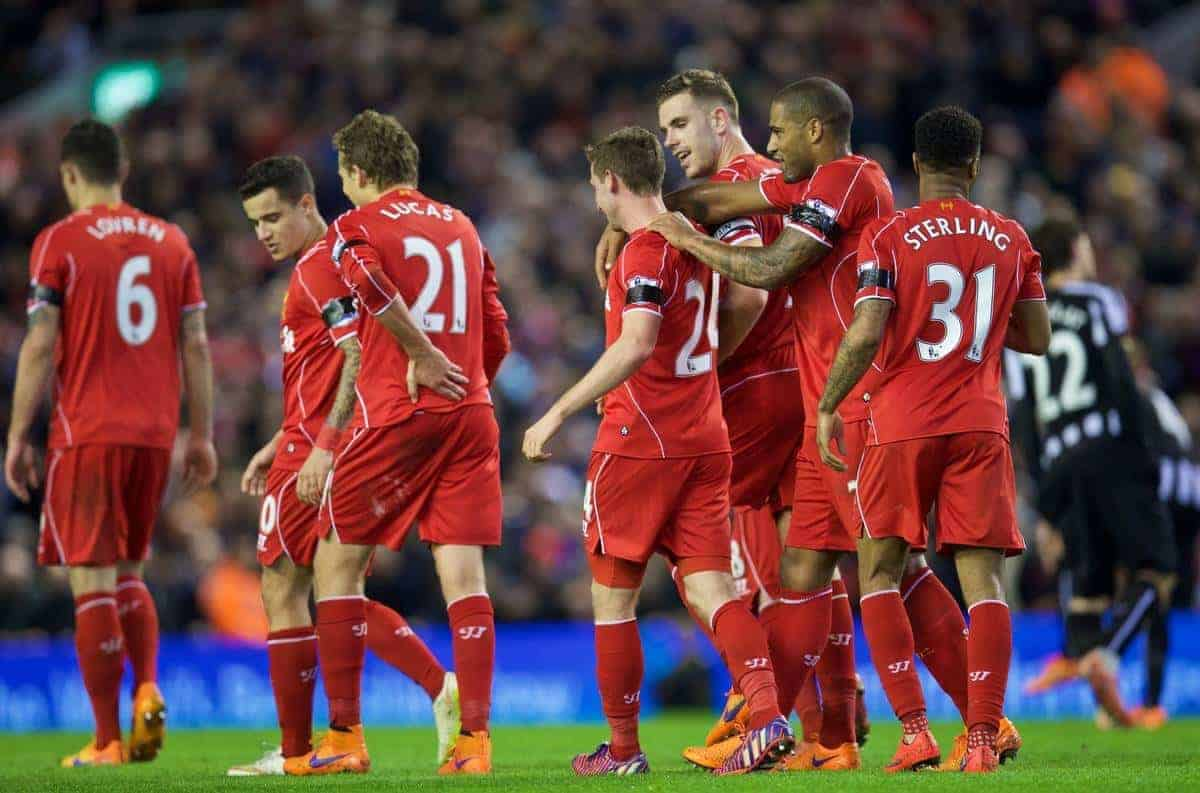 LIVERPOOL, ENGLAND - Monday, April 13, 2015: Liverpool's Joe Allen is mobbed by team-mates as he celebrates scores the second goal against Newcastle United during the Premier League match at Anfield. (Pic by David Rawcliffe/Propaganda)