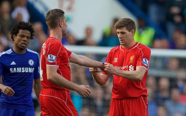 LONDON, ENGLAND - Sunday, May 10, 2015: Liverpool's captain Steven Gerrard hands the captain's armband on to Jordan Henderson during the Premier League match against Chelsea at Stamford Bridge. (Pic by David Rawcliffe/Propaganda)
