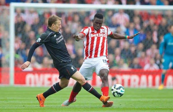 STOKE-ON-TRENT, ENGLAND - Sunday, May 24, 2015: Liverpool's Lucas Leiva in action against Stoke City's Mame Diram Dioufc during the Premier League match at the Britannia Stadium. (Pic by David Rawcliffe/Propaganda)