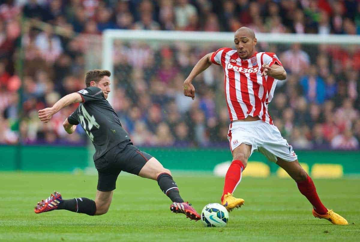 STOKE-ON-TRENT, ENGLAND - Sunday, May 24, 2015: Liverpool's Joe Allen in action against Stoke City's Steven N'Zonzi during the Premier League match at the Britannia Stadium. (Pic by David Rawcliffe/Propaganda)