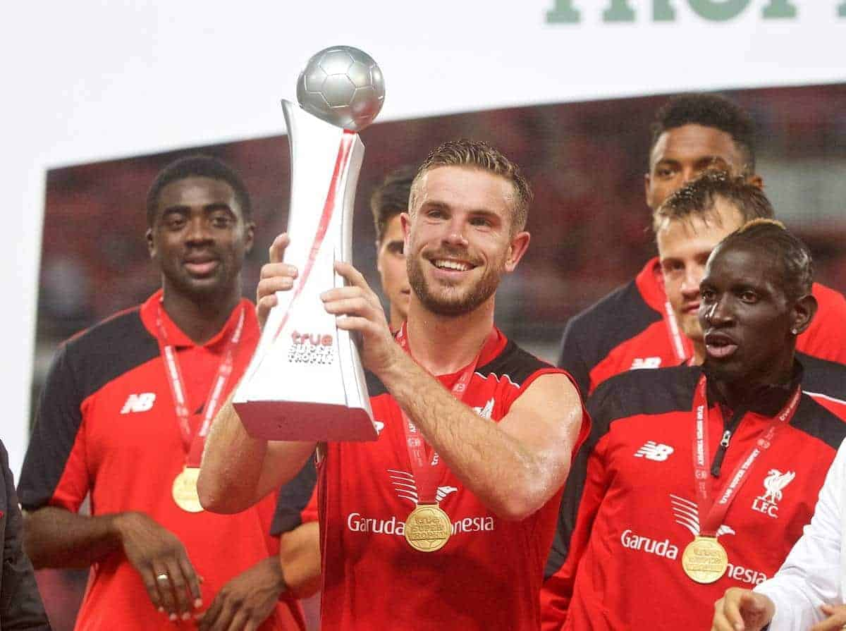 BANGKOK, THAILAND - Tuesday, July 14, 2015: Liverpool's captain Jordan Henderson lifts the trophy after a 4-0 victory over True Thai Premier League All Stars during the True Super Trophy match at the Rajamangala National Stadium on day two of the club's preseason tour. (Pic by David Rawcliffe/Propaganda)