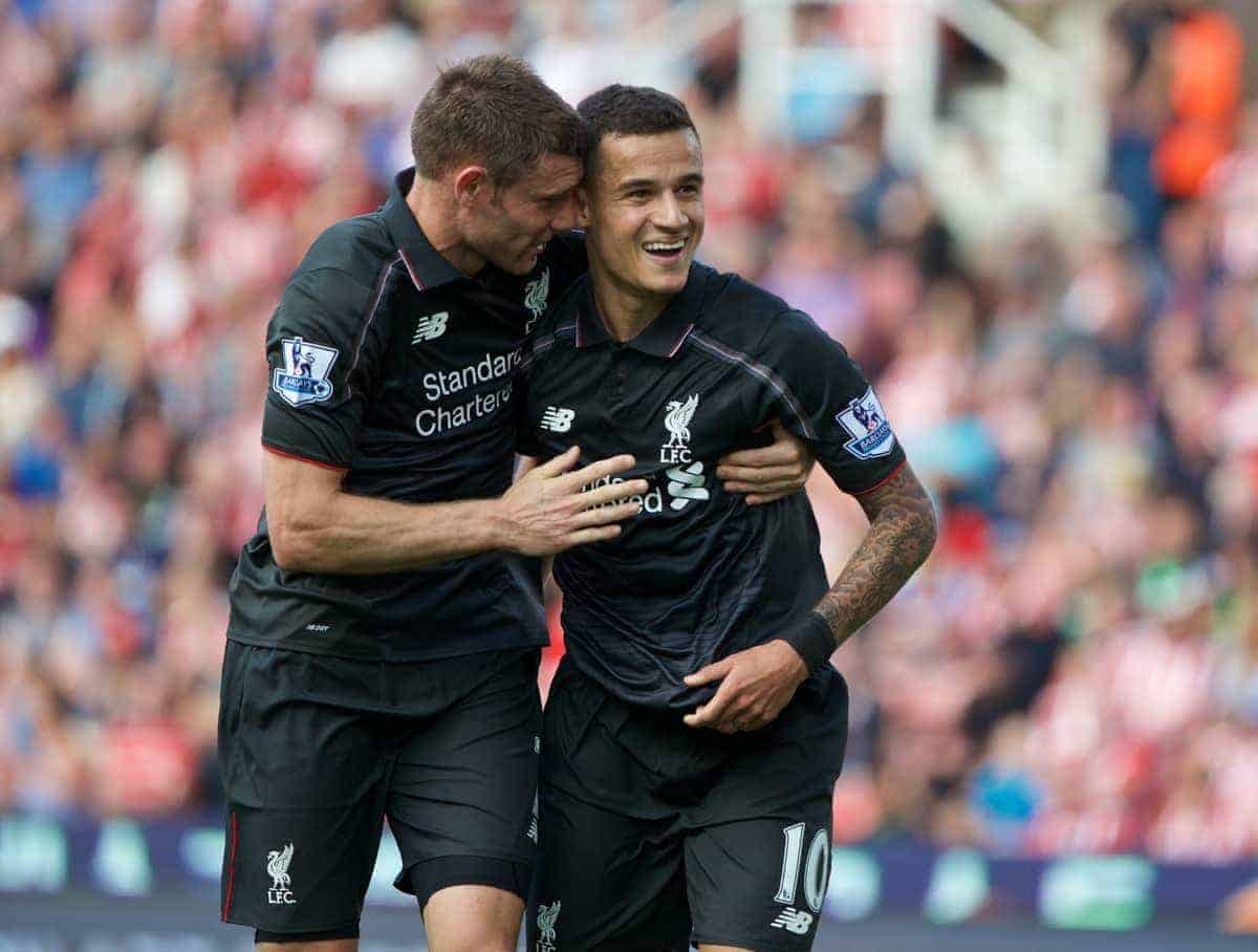 STOKE-ON-TRENT, ENGLAND - Sunday, August 9, 2015: Liverpool's Philippe Coutinho Correia celebrates scoring the first goal against Stoke Citywith team-mate James Milner during the Premier League match at the Britannia Stadium. (Pic by David Rawcliffe/Propaganda)