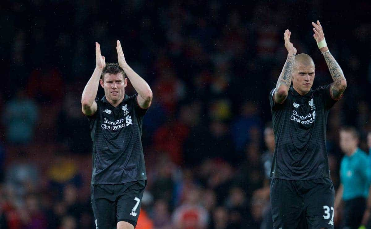 LONDON, ENGLAND - Monday, August 24, 2015: Liverpool's James Milner and Martin Skrtel applaud the travelling supporters after the goal-less draw against Arsenal during the Premier League match at the Emirates Stadium. (Pic by David Rawcliffe/Propaganda)