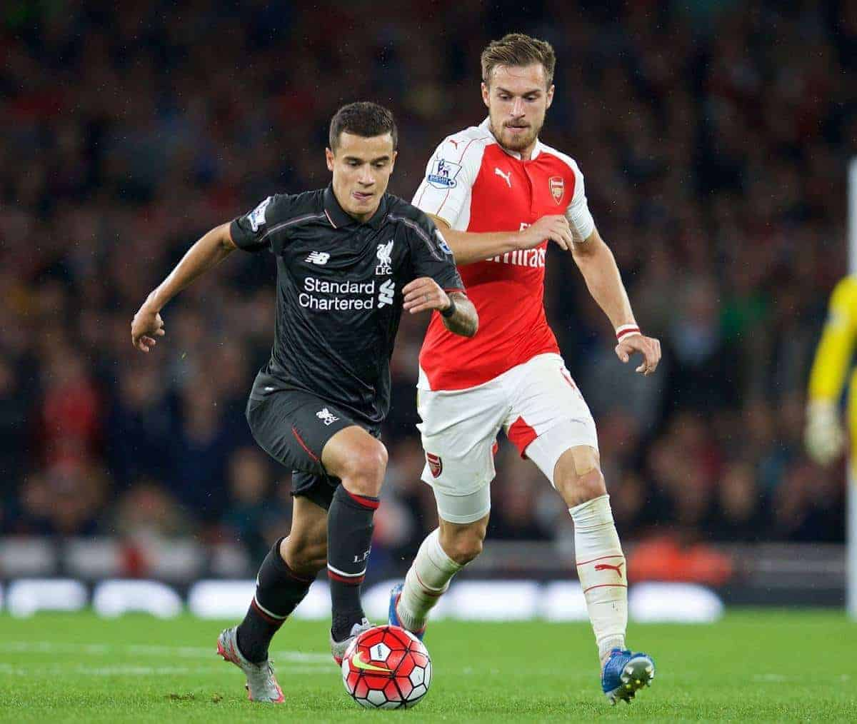 LONDON, ENGLAND - Monday, August 24, 2015: Liverpool's Philippe Coutinho Correia in action against Arsenal's Aaron Ramsey during the Premier League match at the Emirates Stadium. (Pic by David Rawcliffe/Propaganda)