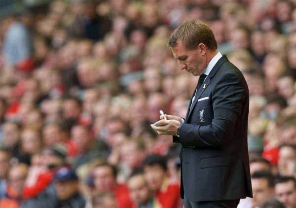 LIVERPOOL, ENGLAND - Sunday, September 20, 2015: Liverpool's manager Brendan Rodgers taking notes during the Premier League match against Norwich City at Anfield. (Pic by David Rawcliffe/Propaganda)