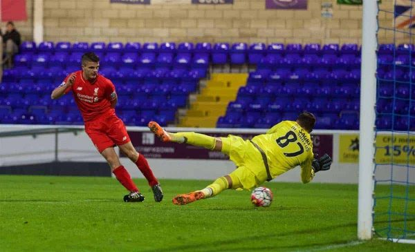 CHESTER, ENGLAND - Friday, October 23, 2015: Liverpool's Tom Brewitt puts the ball past Benfica's goalkeeper Miguel Santos only to be ruled offside during the Premier League International Cup match at the Deva Stadium. (Pic by David Rawcliffe/Propaganda)