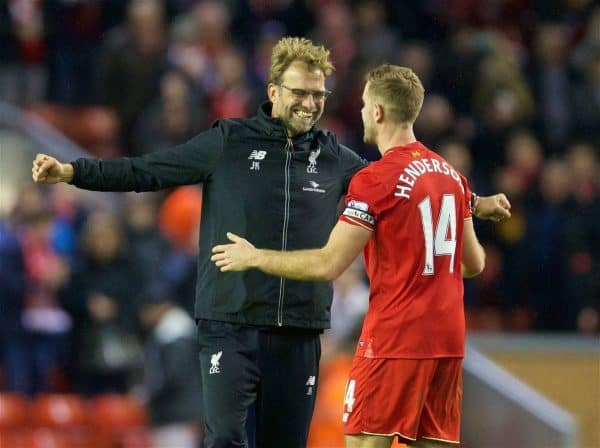 LIVERPOOL, ENGLAND - Boxing Day, Saturday, December 26, 2015: Liverpool's manager Jürgen Klopp celebrates the 1-0 victory over Leicester City with captain Jordan Henderson during the Premier League match at Anfield. (Pic by David Rawcliffe/Propaganda)