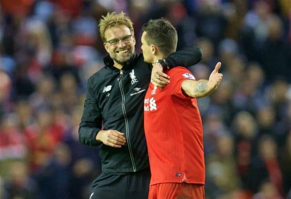 LIVERPOOL, ENGLAND - Boxing Day, Saturday, December 26, 2015: Liverpool's manager Jürgen Klopp celebrates the 1-0 victory over Leicester City with Dejan Lovren during the Premier League match at Anfield. (Pic by David Rawcliffe/Propaganda)