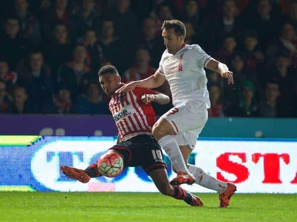 EXETER, ENGLAND - Friday, January 8, 2016: Liverpool's Jose Enrique cannot prevent Exeter City's Jamie Reid setting up the opening goal during the FA Cup 3rd Round match at St. James Park. (Pic by David Rawcliffe/Propaganda)