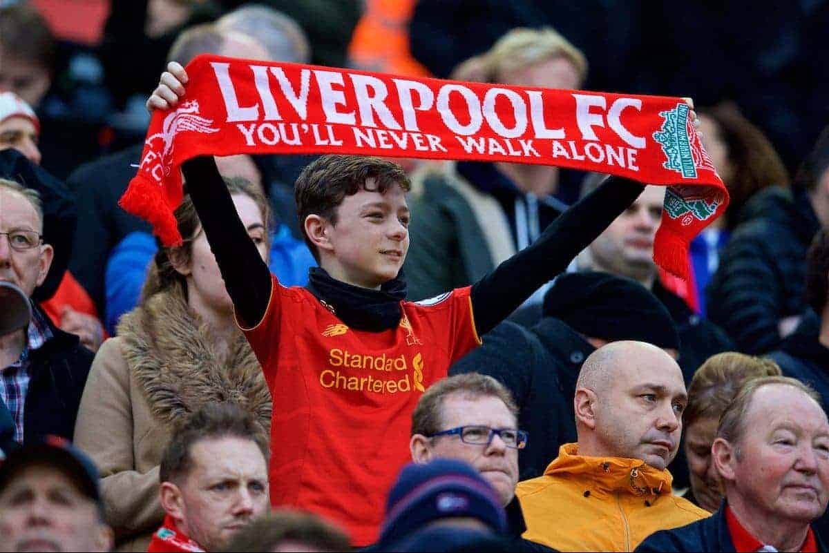 LIVERPOOL, ENGLAND - Saturday, January 7, 2017: A young Liverpool supporter holds up a scarf before the FA Cup 3rd Round match against Plymouth Argyle at Anfield. (Pic by David Rawcliffe/Propaganda)