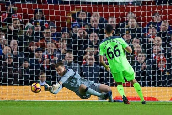 MANCHESTER, ENGLAND - Sunday, January 15, 2017: Liverpool's goalkeeper Simon Mignolet makes a save from a free-kick from Manchester United's Zlatan Ibrahimovic during the FA Premier League match at Old Trafford. (Pic by David Rawcliffe/Propaganda)