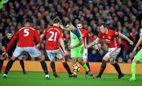 MANCHESTER, ENGLAND - Sunday, January 15, 2017: Liverpool's Philippe Coutinho Correia is surrounded by four Manchester United players during the FA Premier League match at Old Trafford. (Pic by David Rawcliffe/Propaganda)
