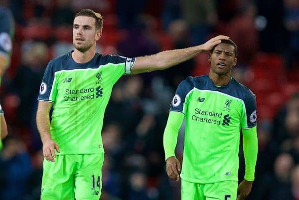 MANCHESTER, ENGLAND - Sunday, January 15, 2017: Liverpool's Georginio Wijnaldum is consoled by captain Jordan Henderson as he looks dejected after drawing 1-1 with Manchester United during the FA Premier League match at Old Trafford. (Pic by David Rawcliffe/Propaganda)