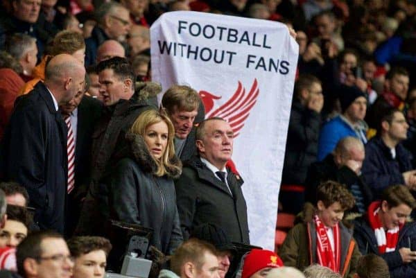 LIVERPOOL, ENGLAND - Saturday, February 6, 2016: Liverpool Managing Director Ian Ayre as fans protest against ticket prices behind him before the Premier League match against Sunderland at Anfield. (Pic by David Rawcliffe/Propaganda)