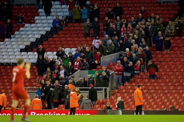 LIVERPOOL, ENGLAND - Saturday, February 6, 2016: Liverpool's James Milner walks off the pitch to an almost empty stadium after supporters staged a 77 minute protest against high ticket prices during the Premier League match against Sunderland at Anfield. (Pic by David Rawcliffe/Propaganda)