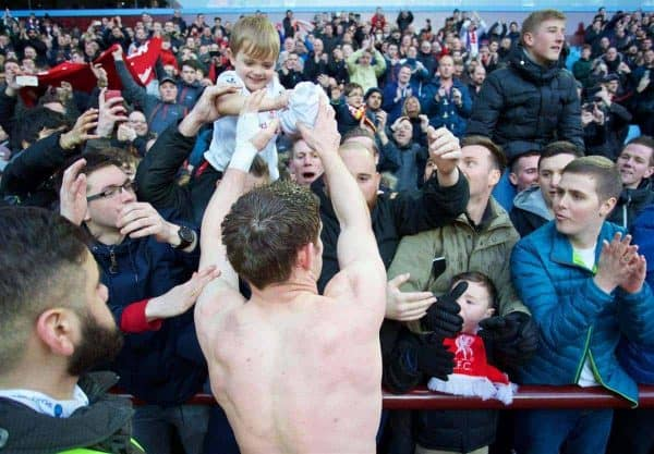 BIRMINGHAM, ENGLAND - Sunday, February 14, 2016: Liverpool's James Milner hands his shirt to a young supporter before the Premier League match against Aston Villa at Villa Park. (Pic by David Rawcliffe/Propaganda)