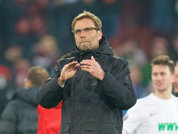 AUGSBURG, GERMANY - Thursday, February 18, 2016: Liverpool's manager Jürgen Klopp applauds the travelling supporters after the goal-less draw against FC Augsburg during the UEFA Europa League Round of 32 1st Leg match at the Augsburg Arena. (Pic by David Rawcliffe/Propaganda)