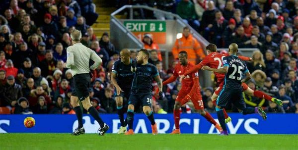 LIVERPOOL, ENGLAND - Wednesday, March 2, 2016: Liverpool's Adam Lallana scores the first goal against Manchester City during the Premier League match at Anfield. (Pic by David Rawcliffe/Propaganda)