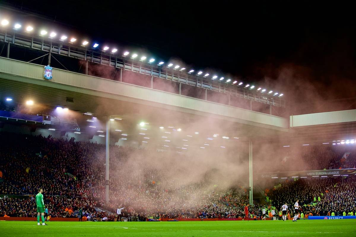 LIVERPOOL, ENGLAND - Thursday, March 10, 2016: Red smoke billows across the pitch from the main stand as Liverpool beat Manchester United 2-0 during the UEFA Europa League Round of 16 1st Leg match at Anfield. (Pic by David Rawcliffe/Propaganda)