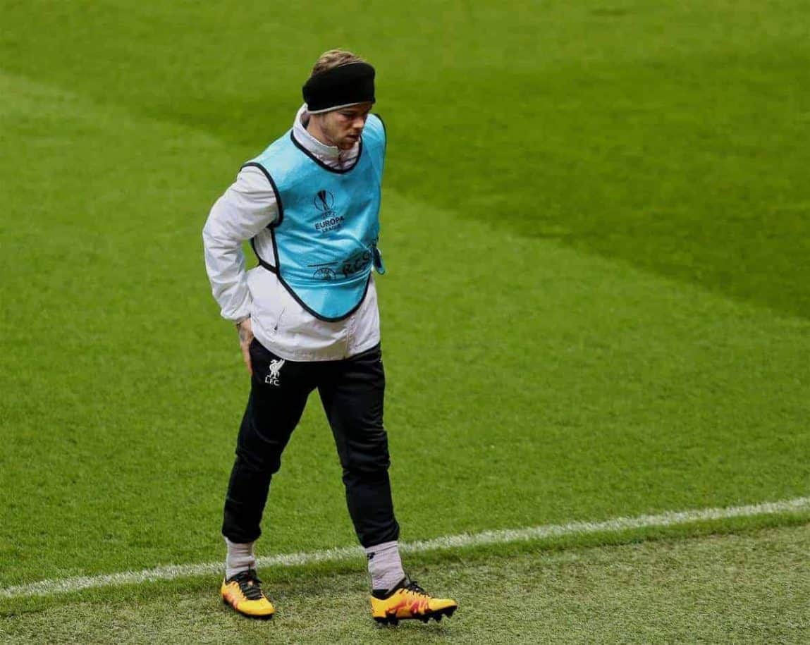MANCHESTER, ENGLAND - Wednesday, March 16, 2016: Liverpool's Alberto Moreno limps off injured during a training session at Old Trafford ahead of the UEFA Europa League Round of 16 2nd Leg match against Manchester United. (Pic by David Rawcliffe/Propaganda)