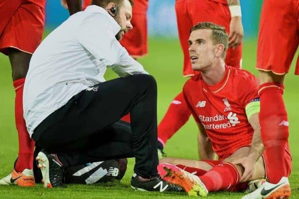 DORTMUND, GERMANY - Thursday, April 7, 2016: Liverpool's captain Jordan Henderson is treated by physiotherapist Chris Morgan for an injury during the UEFA Europa League Quarter-Final 1st Leg match against Borussia Dortmund at Westfalenstadion. (Pic by David Rawcliffe/Propaganda)