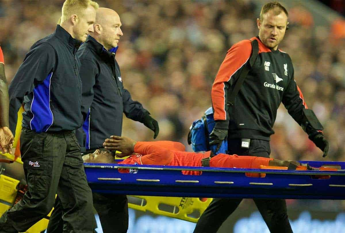 LIVERPOOL, ENGLAND - Wednesday, April 20, 2016: Liverpool's Divock Origi is carried off injured during the Premier League match against Everton at Anfield, the 226th Merseyside Derby. (Pic by David Rawcliffe/Propaganda)