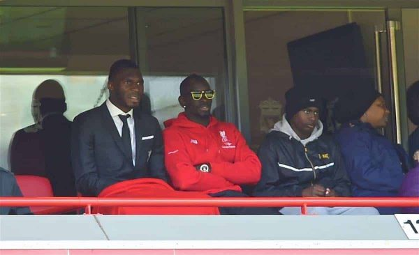 LIVERPOOL, ENGLAND - Saturday, April 23, 2016: Liverpool's Mamadou Sakho [in sunglasses] and Christian Benteke watch their side draw 2-2 with Newcastle United during the Premier League match at Anfield. (Pic by Bradley Ormesher/Propaganda)