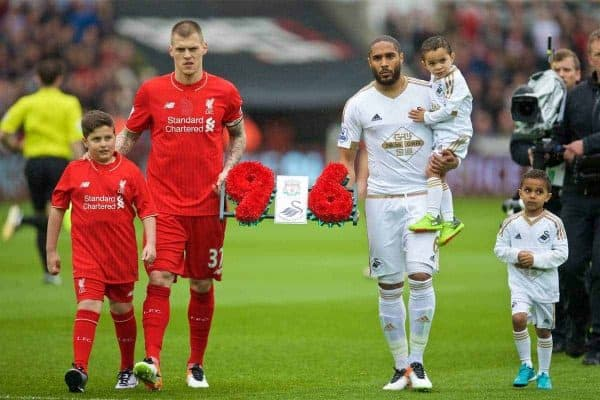 SWANSEA, WALES - Sunday, May 1, 2016: Liverpool's Martin Skrtel and Swansea City's captain Ashley Williams present a floral tribute to the 96 victims of the Hillsborough disaster before the Premier League match at the Liberty Stadium. (Pic by David Rawcliffe/Propaganda)