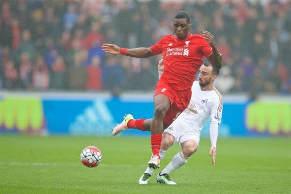 SWANSEA, WALES - Sunday, May 1, 2016: Liverpool's Sheyi Ojo in action against Swansea City's Leon Britton during the Premier League match at the Liberty Stadium. (Pic by David Rawcliffe/Propaganda)