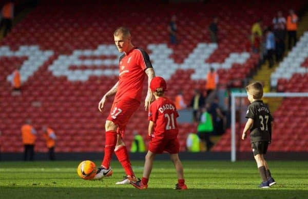 LIVERPOOL, ENGLAND - Sunday, May 8, 2016: Liverpool's Martin Skrtel plays with his children on pitch after the 2-0 victory over Watford during the Premier League match at Anfield. (Pic by David Rawcliffe/Propaganda)
