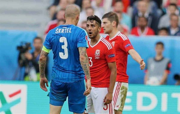 BORDEAUX, FRANCE - Saturday, June 11, 2016: Wales' Neil Taylor goes head-to-head with Slovakia's captain Martin Skrtel during the UEFA Euro 2016 Championship at Stade de Bordeaux. (Pic by David Rawcliffe/Propaganda)