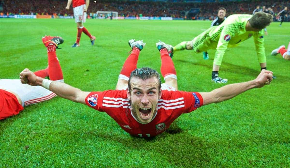 LILLE, FRANCE - Friday, July 1, 2016: Wales' Gareth Bale slides on the pitch as he celebrates a 3-1 victory over Belgium and reaching the Semi-Final during the UEFA Euro 2016 Championship Quarter-Final match at the Stade Pierre Mauroy. (Pic by David Rawcliffe/Propaganda)