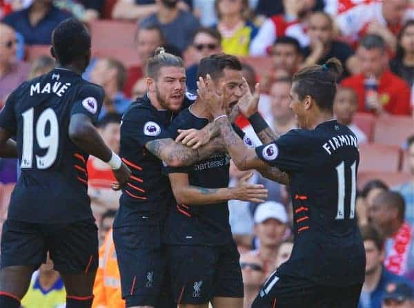 LONDON, ENGLAND - Sunday, August 14, 2016: Liverpool's Philippe Coutinho Correia celebrates scoring the first equalising goal against Arsenal with team-mates Alberto Moreno [L] and Roberto Firmino [R] during the FA Premier League match at the Emirates Stadium. (Pic by David Rawcliffe/Propaganda)