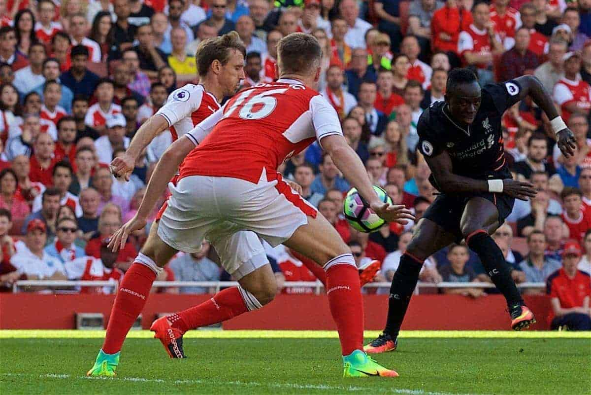 LONDON, ENGLAND - Sunday, August 14, 2016: Liverpool's Sadio Mane in action against Arsenal's Rob Holding during the FA Premier League match at the Emirates Stadium. (Pic by David Rawcliffe/Propaganda)