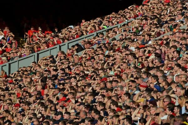 LIVERPOOL, ENGLAND - Saturday, September 10, 2016: Liverpool supporters shield their eyes from the sun during the FA Premier League match against Leicester City at Anfield. (Pic by David Rawcliffe/Propaganda)