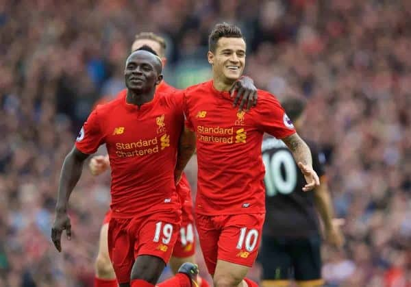 Liverpool's Philippe Coutinho Correia celebrates scoring the fourth goal against Hull City with team-mate Sadio Mane during the FA Premier League match at Anfield. (Pic by David Rawcliffe/Propaganda)