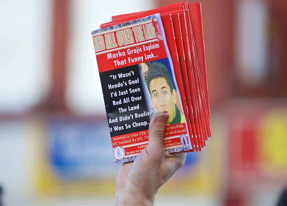 "LIVERPOOL, ENGLAND - Saturday, October 22, 2016: A Liverpool supporter selling a fanzine ""Red All Over The Land"" before the FA Premier League match against West Bromwich Albion at Anfield. (Pic by David Rawcliffe/Propaganda)"