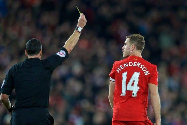 Liverpool's captain Jordan Henderson is shown a yellow card by referee Neil Swarbrick during the FA Premier League match against West Bromwich Albion at Anfield. (Pic by David Rawcliffe/Propaganda)