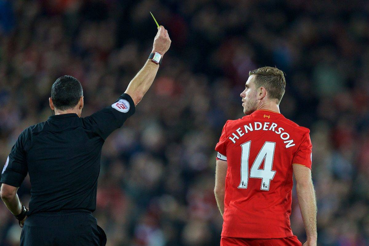 LIVERPOOL, ENGLAND - Saturday, October 22, 2016: Liverpool's captain Jordan Henderson is shown a yellow card by referee Neil Swarbrick during the FA Premier League match against West Bromwich Albion at Anfield. (Pic by David Rawcliffe/Propaganda)