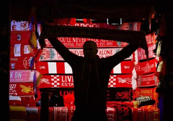 A Liverpool supporter buys a souvenir scarf outside Anfield ahead of the Football League Cup Quarter-Final match between Liverpool and Leeds United. (Pic by David Rawcliffe/Propaganda)