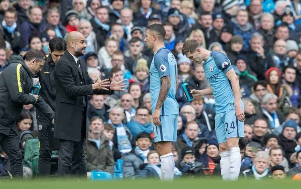 Manchester City's Manager Pep Guardiola gives instructions to Aleksandar Kolarov and John Stones during the FA Premier League match against Chelsea at the City of Manchester Stadium. (Pic by Gavin Trafford/Propaganda)