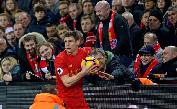 LIVERPOOL, ENGLAND - Sunday, December 11, 2016: Liverpool's James Milner gets the ball from the crowd to take a throw-in during the FA Premier League match against West Ham United at Anfield. (Pic by David Rawcliffe/Propaganda)