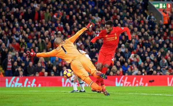LIVERPOOL, ENGLAND - Sunday, December 11, 2016: Liverpool's Divock Origi scores the second goal against West Ham United after a mistake but goalkeeper Darren Randolph to make the score 2-2 during the FA Premier League match at Anfield. (Pic by David Rawcliffe/Propaganda)
