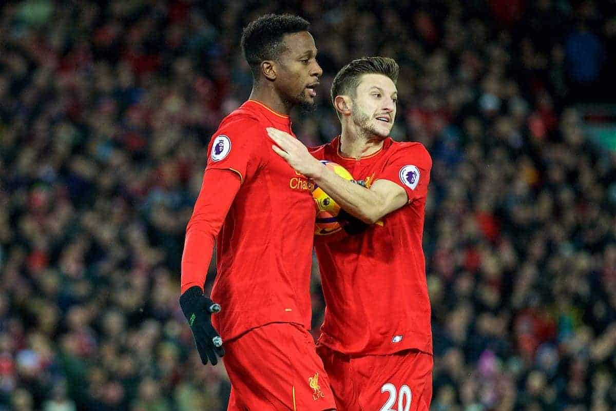LIVERPOOL, ENGLAND - Sunday, December 11, 2016: Liverpool's Divock Origi scores the second goal against West Ham United with team-mate Adam Lallana to make the score 2-2 during the FA Premier League match at Anfield. (Pic by David Rawcliffe/Propaganda)