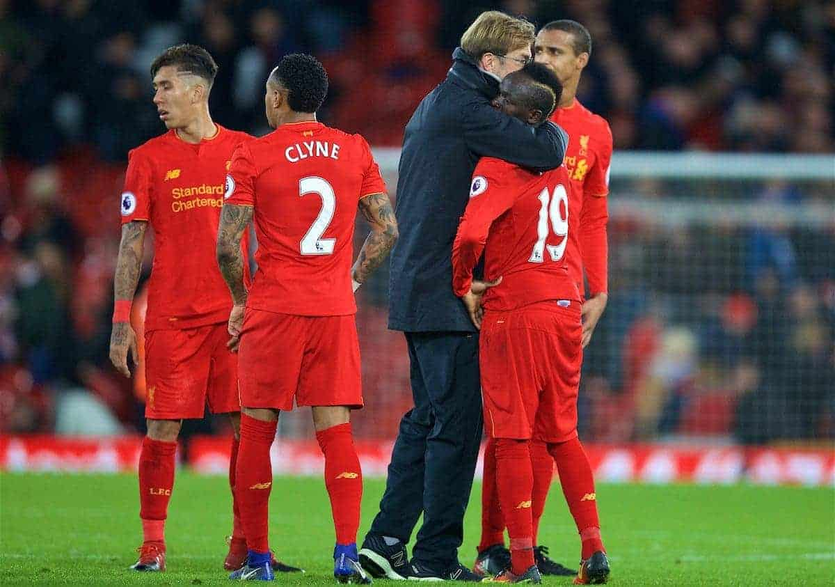 LIVERPOOL, ENGLAND - Sunday, December 11, 2016: Liverpool's manager Jürgen Klopp embraces Sadio Mane after the 2-2 home draw with West Ham United during the FA Premier League match at Anfield. (Pic by David Rawcliffe/Propaganda)