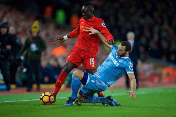 LIVERPOOL, ENGLAND - Tuesday, December 27, 2016: Liverpool's Sadio Mane in action against Stoke City's Erik Pieters during the FA Premier League match at Anfield. (Pic by David Rawcliffe/Propaganda)