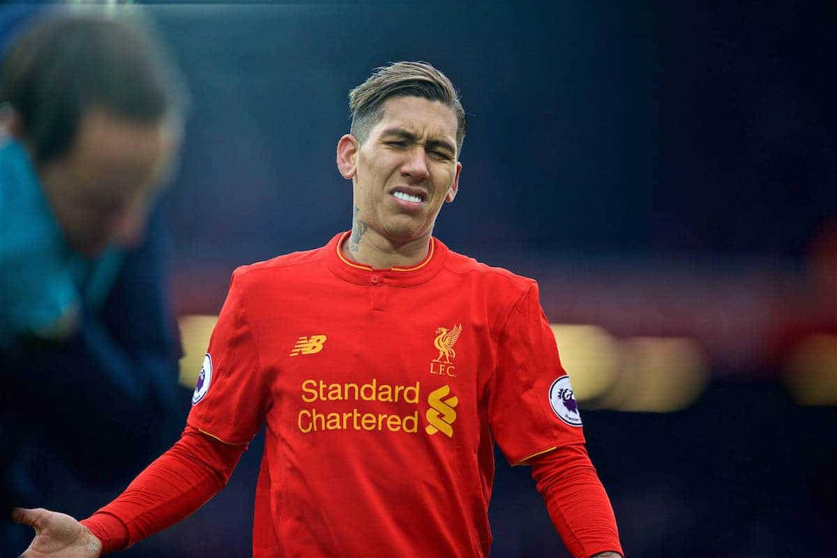 LIVERPOOL, ENGLAND - Saturday, January 21, 2017: Liverpool's Roberto Firmino looks dejected as his side lose 3-2 to Swansea City during the FA Premier League match at Anfield. (Pic by David Rawcliffe/Propaganda)