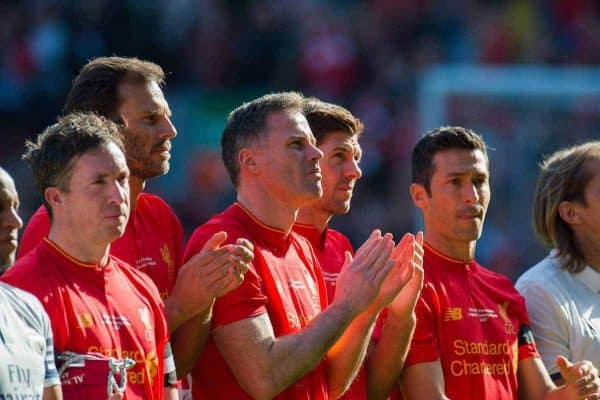Liverpoolís Jamie Carragher is joined by the players from both teams in a minute applause for the former Liverpool player Ronnie Moran who died this week before a Legends friendly match against Real Madrid at Anfield. (Pic by Peter Powell/Propaganda)