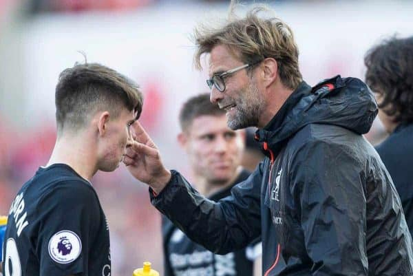STOKE-ON-TRENT, ENGLAND - Saturday, April 8, 2017: Liverpool's manager Jurgen Klopp speaks with Ben Woodburn during the FA Premier League match against Stoke City at the Bet365 Stadium. (Pic by Laura Malkin/Propaganda)