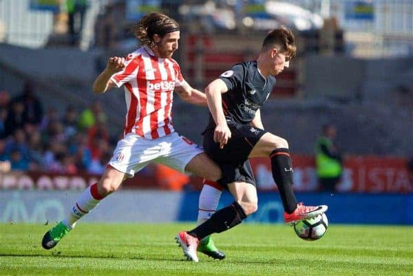 STOKE-ON-TRENT, ENGLAND - Saturday, April 8, 2017: Liverpool's Ben Woodburn in action against his Wales international team-mate Stoke City's Joe Allen during the FA Premier League match at the Bet365 Stadium. (Pic by David Rawcliffe/Propaganda)